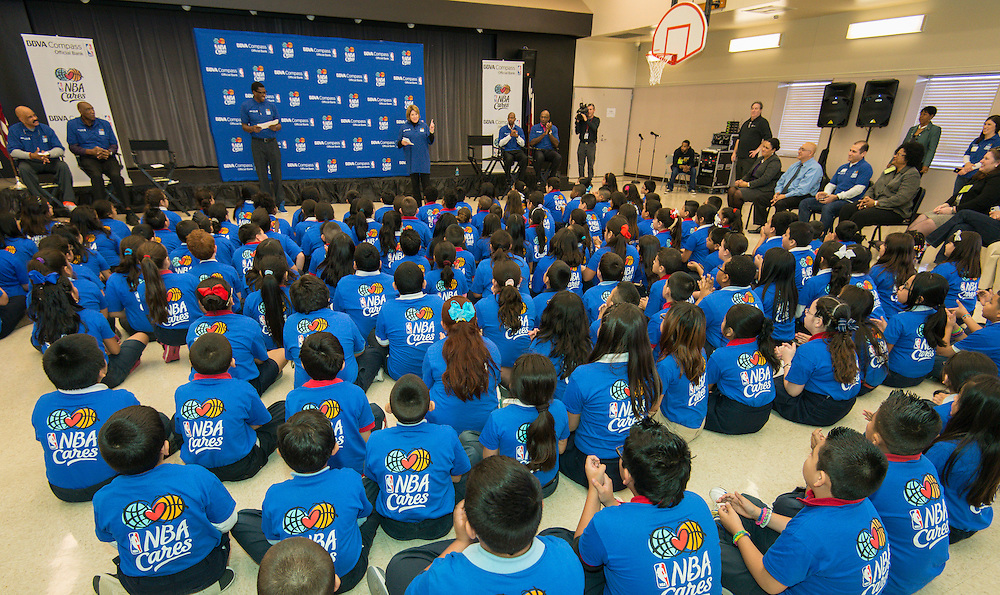 Former NBA player Felipe Lopez and BBVA's Karen Dixon talk with students during a financial education and success program sponsored by NBA Cares and BBVA Compass at Crespo Elementary School, February 27, 2014.
