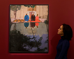 "© Licensed to London News Pictures. 25/11/2016. London, UK. A staff member views ""Prayer, Samarkand"" by Daniil Stepanov (est. GBP 150-200k), at the preview of artworks from Sotheby's upcoming Russian sales in New Bond Street, where over three hundred works spanning several centuries will be offered. Photo credit : Stephen Chung/LNP"
