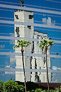 An old grain silo reflected in a modern high tech building in Tempe, Arizona.