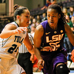 November 19, 2011; New Orleans, LA; LSU Lady Tigers forward LaSondra Barrett (55) drives past Tulane Green Wave guard/forward Janique Kautsky (24) during the first half of a game at Avron B. Fogelman Arena.  Mandatory Credit: Derick E. Hingle-US PRESSWIRE