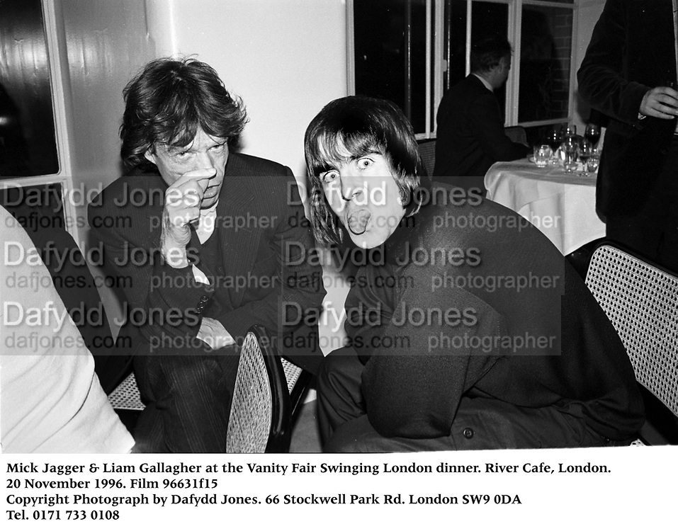 Mick Jagger & Liam Gallagher at the Vanity Fair Swinging London dinner. River Cafe, London. 20 November 1996. Film 96631f15<br />Copyright Photograph by Dafydd Jones<br />66 Stockwell Park Rd. London SW9 0DA<br />Tel. 0171 733 0108