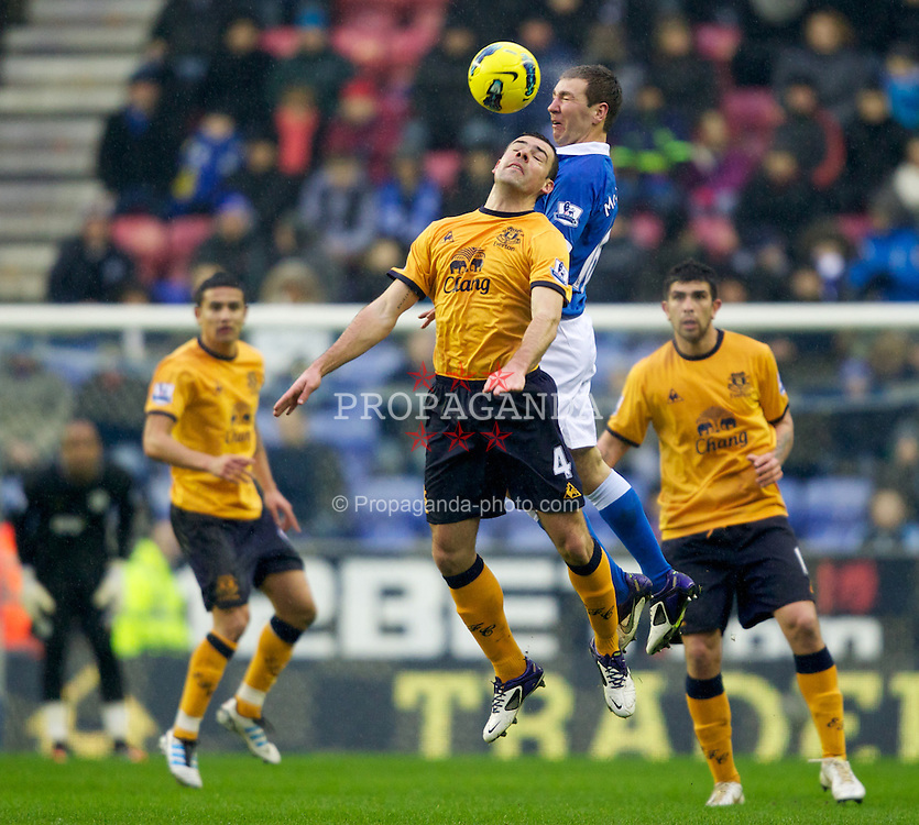 WIGAN, ENGLAND - Saturday, February 4, 2012: Everton's Darron Gibson in action against Wigan Athletic's James McArthur during the Premiership match at the JJB Stadium. (Pic by Vegard Grott/Propaganda)