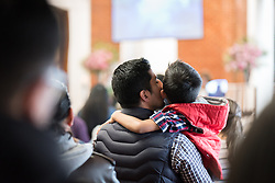 18 November 2018, Bogotá, Colombia: A father kisses his son during Sunday service in the Church of San Lucas. The church of San Lucas ('Saint Lucas') of the Evangelical Lutheran Church of Colombia, brings together a congregation of some 100 people in the southern areas of Bogotá. Located in the Kennedy area, the church has recently celebrated 50 years. As part of its ministry, the church runs a school and college, The Colegio Evangelico Luterano de Colombia (CELCO) San Lucas, offering education to just over 1,000 students aged 3-18. The school started as a social initiative offering care for children aged 0-4 in Bogotá's less wealthy neighbourhood, allowing the parents opportunities to go to work. 36 years after its foundation, the school employs 56 staff, of which 36 are teachers.