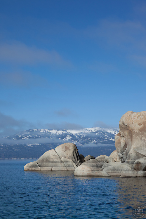 """Boulders on Lake Tahoe 15"" - These boulders and snow covered mountain were photographed from a boat on the East shore of Lake Tahoe."