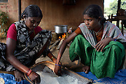 In the village of nendra, seven kilometres away from Errabore Salwa Judam camp, tribal women prepare food. The eviction of jungle dwelling tribals, or adavasi as they are known, by the Salwa Judam was seen as a way of starving the Naxalites from their source of food.