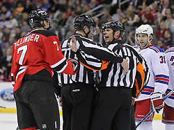 Nov 5, 2010; Newark, NJ, USA;  Referee Mike Leggo (3) yells at New Jersey Devils defenseman Henrik Tallinder (7) during the second period at the Prudential Center.
