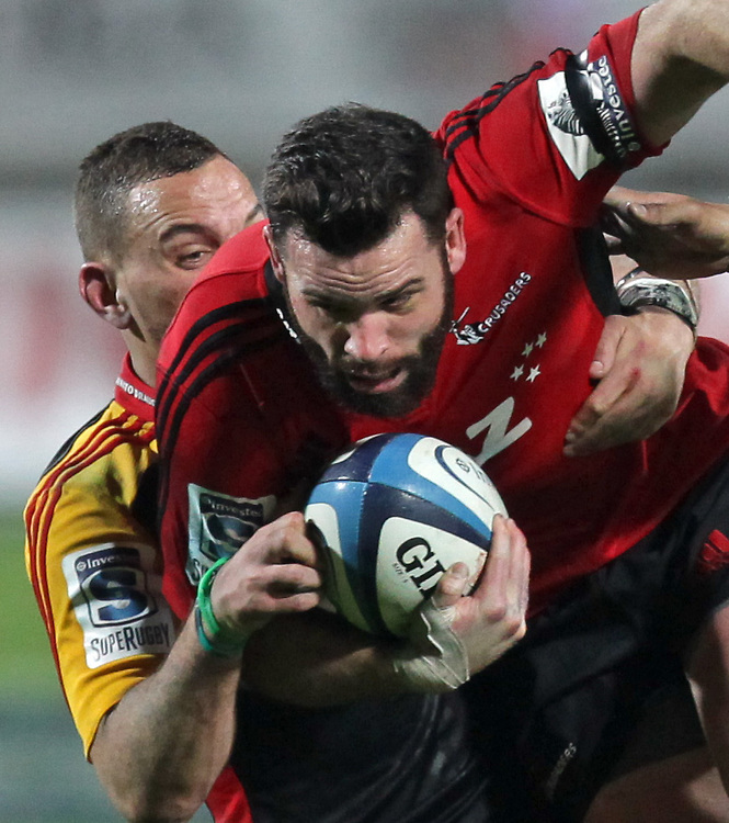 Chiefs' Aaron Cruden tackles Crusaders' Ryan Crotty in a Super Rugby semi final match, Waikato Stadium, Hamilton, New Zealand, Saturday, July 27, 2013.  Credit:SNPA / David Rowland