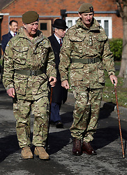 The Prince of Wales (left), Colonel Welsh Guards, walks across the parade ground after presenting campaign medals to soldiers from the 1st Battalion Welsh Guards at Elizabeth Barracks, Pirbright Camp in Woking, following their return from Afghanistan.