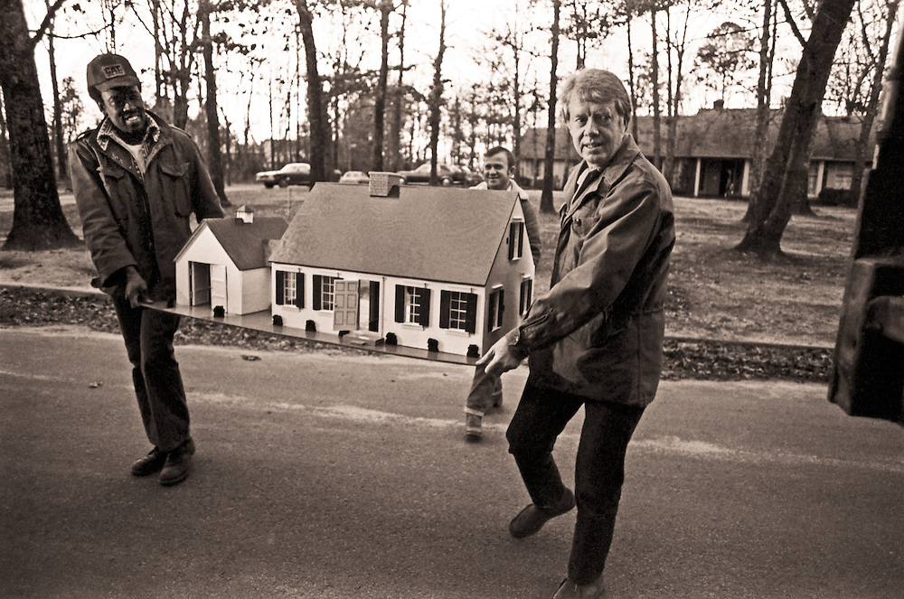 The president-elect and helpers carry his daughter's dollhouse—one that Carter handcrafted for Amy—to a moving van for the trip from Plains to the White House.