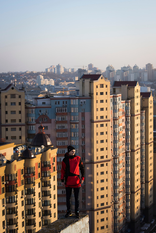 Extreme climber Mustang Wanted poses for a portrait at the end of a ledge on the roof of a 26-storey building on February 19, 2017 in the Shevchenkovski District of Kiev, Ukraine.