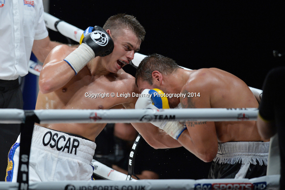 Oscar Ahlin (white shorts) defeats Olegs Fedotovs in a Light Heavyweight contest at the SSE Wembley Arena, London on the 20th September 2014. Sauerland Promotions. Credit: Leigh Dawney Photography.