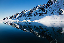 A mirror reflection of a snowy arctic mountain,Svalbard, Norway