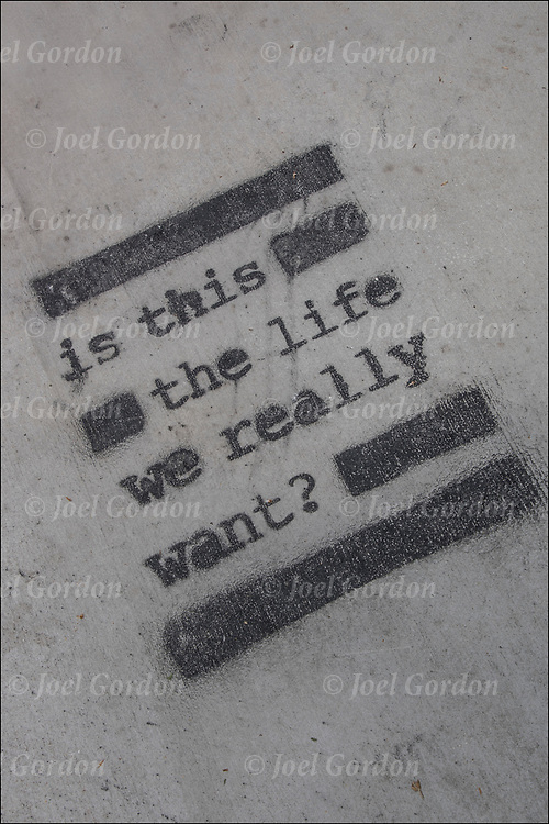 Stencil Street Art - &quot;is this the life we really want?&quot;<br /> <br /> Stencil graffiti is a form of graffiti that makes use of stencils  to create an image or text that is easily reproducible. The desired design is cut out of the selected medium and then the image is transferred to a surface through the use of spray paint or roll-on paint.<br /> <br /> Street art can be a powerful platform for reaching people in public spaces.