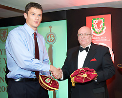 CARDIFF, WALES - Tuesday, October 7, 2008: Wales' Owain Tudur Jones receives his international cap from FAW President Peter Rees at the Brains Beer Wales Football Awards at the Millennium Stadium. (Photo by David Rawcliffe/Propaganda)