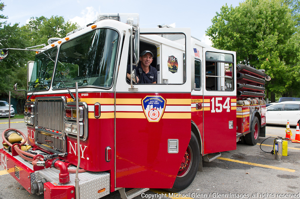 19 Sep 2015 Staten Island, New York US // Engine 154 is present at the 8th annual Lt. John Martinson Memorial Picnic to show the children the apparatus //  Michael Glenn  /   for the FDNY