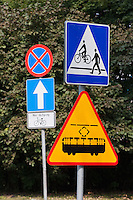 Polish signs for tram crossing, Pedestrian Crossing and one way bike crossing in Krakow Poland