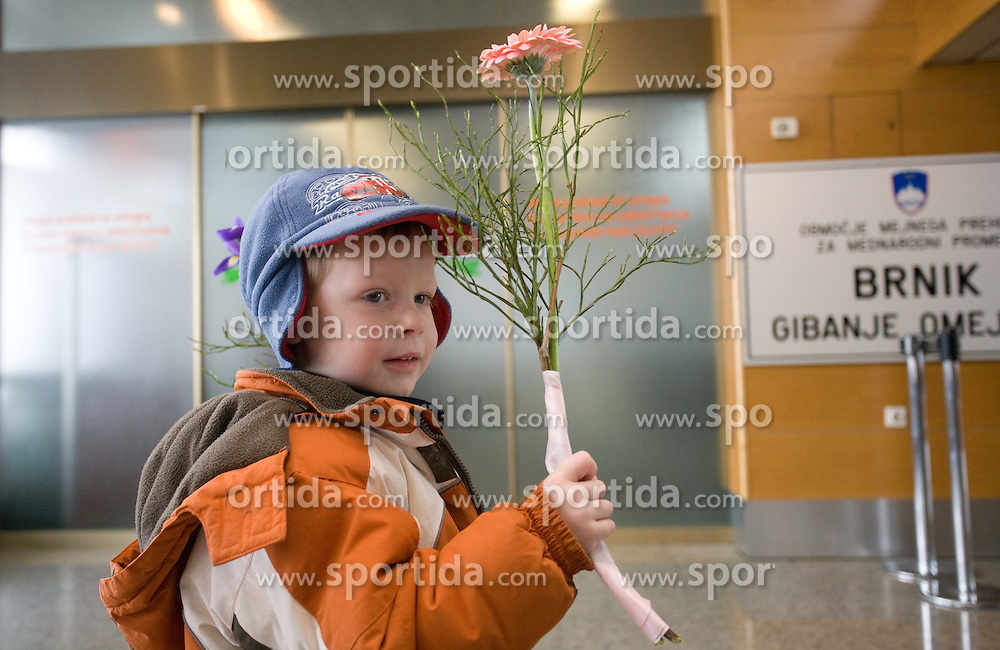 Boy with flower waiting for his parents at arrival to Airport Joze Pucnik, on February 23, 2010 in Brnik, Slovenia. (Photo by Vid Ponikvar / Sportida)