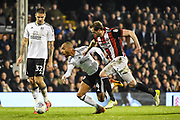 Fulham Defender Denis Odoi (4) and Sheffield United Defender Richard Stearman (19) battle for the ball during the EFL Sky Bet Championship match between Fulham and Sheffield United at Craven Cottage, London, England on 6 March 2018. Picture by Stephen Wright.