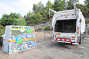 Truck collects plastic bottles for recycling