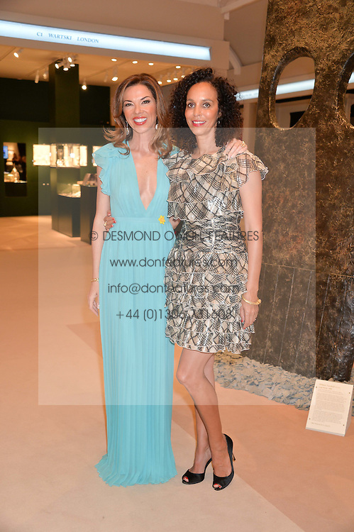 Leftto right, HEATHER KERZNER and JEANETTE CALLIVA at the Masterpiece Marie Curie Party supported by Jeager-LeCoultre held at the South Grounds of The Royal Hospital Chelsea, London on 30th June 2014.
