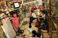 Young children watch TV in a shop in Matamoros, Mexico on April 23, 2010. Matamoros has long been controlled by drug cartels and of late the city has been besieged by violence between cartels vying for control of the lucrative drug trade. (Photo/Scott Dalton)