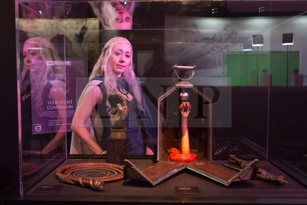 © Licensed to London News Pictures. 09/02/2015. London, UK. A woman dressed as a character from the series looks at exhibits at the Game of Thrones Exhibition on 9th February 2014 at the O2 Arena in Greenwich, south-east London. Photo credit : Vickie Flores/LNP