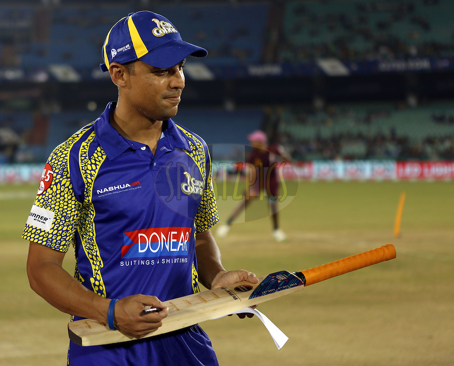Justin Ontong captain of Cape Cobras signs the bat during the toss of the  match 3 of the Oppo Champions League Twenty20 between the Cape Cobras and the Northern Knights held at the Chhattisgarh International Cricket Stadium, Raipur, India on the 19th September 2014<br /> <br /> Photo by:  Sandeep Shetty / Sportzpics/ CLT20<br /> <br /> <br /> Image use is subject to the terms and conditions as laid out by the BCCI/ CLT20.  The terms and conditions can be downloaded here:<br /> <br /> http://sportzpics.photoshelter.com/gallery/CLT20-Image-Terms-and-Conditions-2014/G0000IfNJn535VPU/C0000QhhKadWcjYs