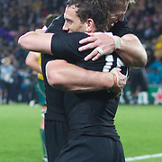 Aaron Cruden, New Zealand, is congratulated by Brad Thorn after New Zealand's victory during the New Zealand V Australia Semi Final match at the IRB Rugby World Cup tournament, Eden Park, Auckland, New Zealand, 16th October 2011. Photo Tim Clayton...