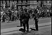 Madison, WI – May, 1970. Police in riot gear watching protesters. On May 1, 1970, there was a general student strike in response to the news that the U.S. had expanded bombing into Cambodia. There was a march against the war, led by Veterans for Peace in Vietnam; and after the May 4 shootings at Kent State University in Ohio, there were more protests at UW Madison, which led to the police being called in, and teargassing demonstrators in the streets and on campus.