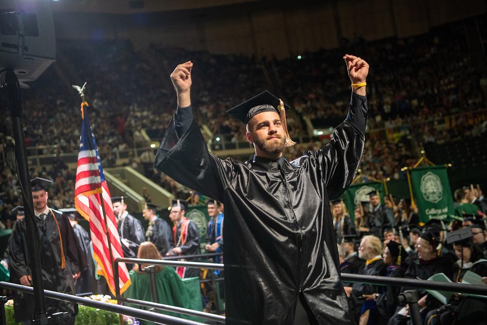 Kyle Downs participates ni spring undergraduate commencement. Photo by Ben Siegel