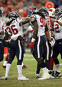 Houston Texans linebacker Jadeveon Clowney (90) gets a pat on the helmet from Houston Texans strong safety D.J. Swearinger (36) after tackling Arizona Cardinals running back Stepfan Taylor (30) for a loss on a first quarter running play during the 2014 NFL preseason football game against the Arizona Cardinals on Saturday, Aug. 9, 2014 in Glendale, Ariz. The Cardinals won the game in a 32-0 shutout. ©Paul Anthony Spinelli