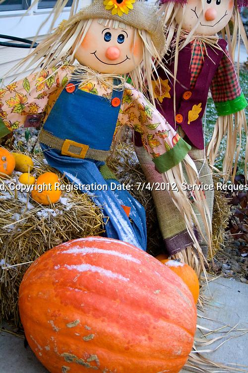 Straw stuffed Halloween couple with pumpkin in an autumn or harvest scene. Battle Lake Minnesota MN USA
