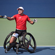 2017 U.S. Open Tennis Tournament - DAY FOURTEEN. Stephane Houdet of France in action while winning the Wheelchair Men's Singles Final against Alfie Hewett of Great Britain at the US Open Tennis Tournament at the USTA Billie Jean King National Tennis Center on September 10, 2017 in Flushing, Queens, New York City.  (Photo by Tim Clayton/Corbis via Getty Images)