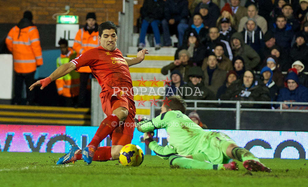 LONDON, ENGLAND - Wednesday, February 12, 2014: Liverpool's Luis Suarez in action against Fulham's goalkeeper Maarten Stekelenburg during the Premiership match at Craven Cottage. (Pic by David Rawcliffe/Propaganda)