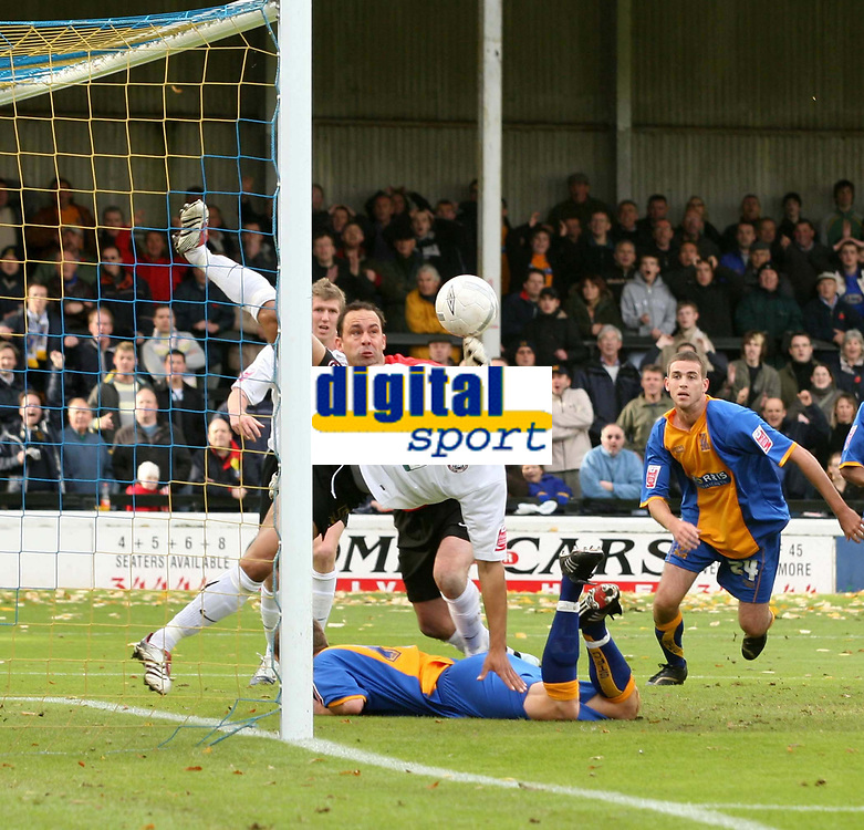 Shrewsbury town v Hereford,Fa cup first round.<br />11-11-2006.<br />Richard Hope(L)clears Herefords goal line.