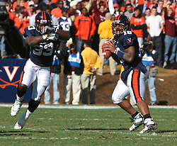 Virginia quarterback Marques Hagans (18) on a play action pass with RB Wali Lundy (33) against VT.  The Virginia Tech Hokies defeated The Virginia Cavaliers 52-14 on November 19, 2005 at Scott Stadium in Charlottesville, VA.