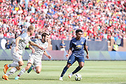 Manchester United Defender Demi Mitchell is chased by Liverpool defender Ragnar Klavan (17) and Liverpool midfielder Adam Lallana (20) during the Manchester United and Liverpool International Champions Cup match at the Michigan Stadium, Ann Arbor, United States on 28 July 2018.