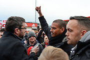 Ex-Forest player Stan Collymore gives the thumbs up while being interviewed during Nottingham Forest fans stage a peaceful demonstration to show their frustration against Forest chairman Fawaz Al-Hasawi ahead of the EFL Sky Bet Championship match between Nottingham Forest and Bristol City at the City Ground, Nottingham, England on 21 January 2017. Photo by Jon Hobley.1 January 2017. Photo by Jon Hobley.