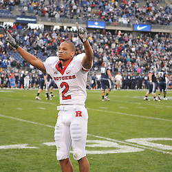 Oct 31, 2009; East Hartford, CT, USA; Tim Brown signals to Rutgers fans after Rutgers' 28-24 victory over Connecticut in Big East NCAA football at Rentschler Field.