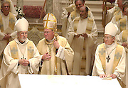 Archbishop Emeritus Rembert Weakland, Archbishop Timothy Dolan and Auxiliary Bishop Richard Sklba are pictured at the altar at St. John the Evangelist Cathedral in Milwaukee during the annual Chrism Mass in April 2003. (Sam Lucero photo)