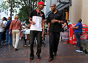 Chas Anderson, left, and Nazareth Miller on Gibbs Street during the Xerox Rochester International Jazz Festival on Saturday, June 21, 2014.