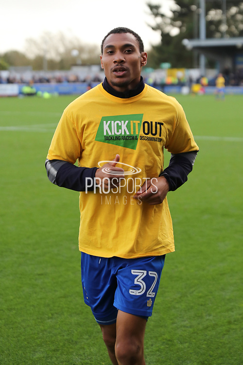 AFC Wimbledon defender Darius Charles (32) warming up during the EFL Sky Bet League 1 match between AFC Wimbledon and Plymouth Argyle at the Cherry Red Records Stadium, Kingston, England on 21 October 2017. Photo by Matthew Redman.