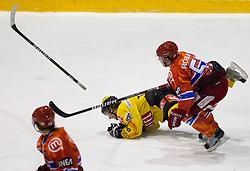 Martin Ulmer of Vienna vs Mitja Robar of Acroni Jesenice during  ice-hockey match between HK Acroni Jesenice and EV Vienna Capitals of 44th Round of EBEL league, on January 30, 2011 in Arena Podmezkla, Jesenice, Slovenia. Acroni Jesenice defeated Vienna 4-3. (Photo By Vid Ponikvar / Sportida.com)
