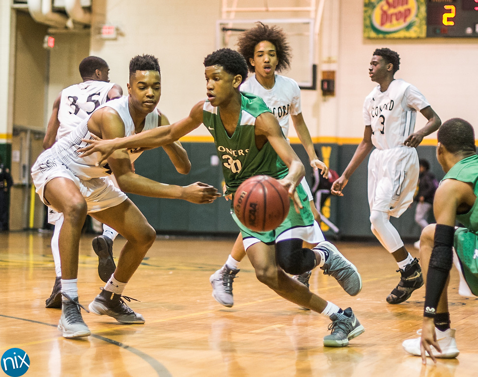 Kannapolis's Amare Haynie (30) gets control of a loose ball during a South Piedmont Conference basketball game Saturday night at Central Cabarrus High School.