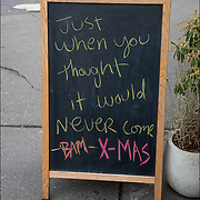 Blackboard Christmas Sign outside of restaurant in West Village.<br />