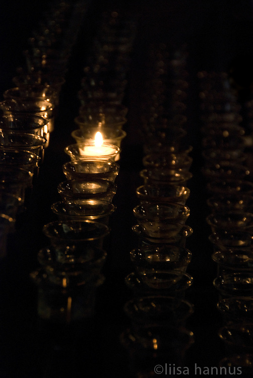 A single votive candle is lit at St. Bartholomew's Church in New York City.