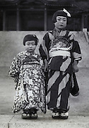 three and seven years old girl made up for her Shichi Go San celebration Japan late 1940s
