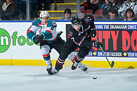 KELOWNA, CANADA - FEBRUARY 14:  Marek Skvrne #9 of the Kelowna Rockets stick checks Reese Johnson #17 of the Red Deer Rebels as he skates with the puck on February 14, 2018 at Prospera Place in Kelowna, British Columbia, Canada.  (Photo by Marissa Baecker/Shoot the Breeze)  *** Local Caption ***