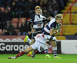 Bristol Rugby's replacement winger, Charlie Amesbury is challenged by London Scottish replacement scrum half, Matt Heeks - Photo mandatory by-line: Dougie Allward/JMP - Mobile: 07966 386802 - 05/12/2014 - SPORT - Rugby - Bristol - Ashton Gate - Bristol Rugby v London Scottish - B&I Cup