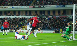 BLACKBURN, ENGLAND - Monday, April 2, 2012: Manchester United's Javier Hernandez sees his shot rebound off the post into the hands of Blackburn Rovers' goalkeeper Paul Robinson during the Premiership match at Ewood Park. (Pic by David Rawcliffe/Propaganda)